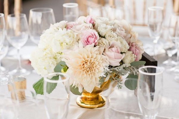 Gold mercury vases filled with dahlias, garden roses, spray roses, hydrangea, dusty miller &...