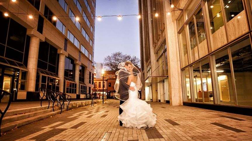 Bride and groom on Fayetteville Street in Raleigh, NC