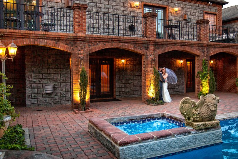 Bride and groom by the pool at Barclay Villa