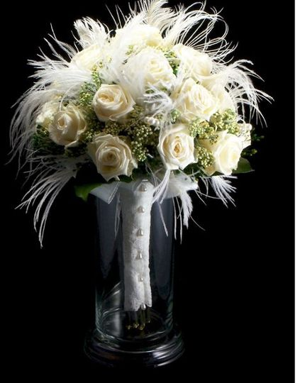 Wispy white bouquet. Real preserved white roses, rice flower,& white ostrich feathers.