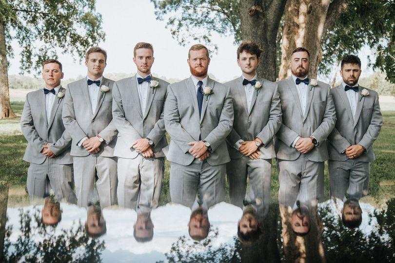 Dapper wedding party pose