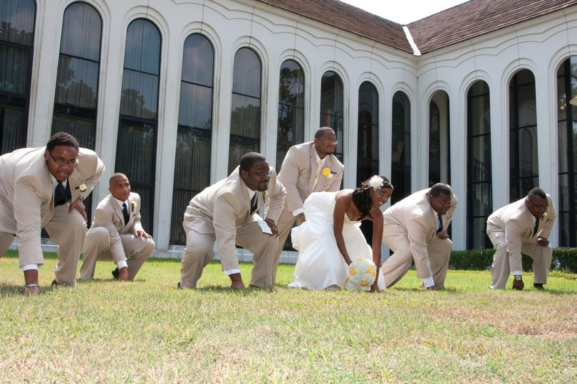 Couple with their groomsmen