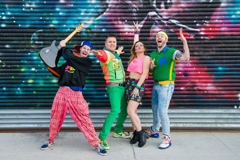 90s outfits with graffiti backdrop