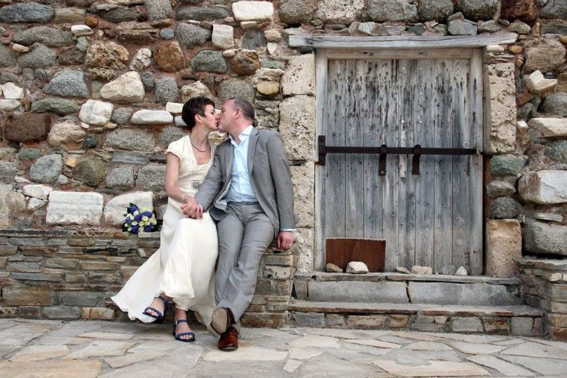 An elegant civil wedding in the Old Town of Naxos, Greece. English couple Katharine and Keith had a...