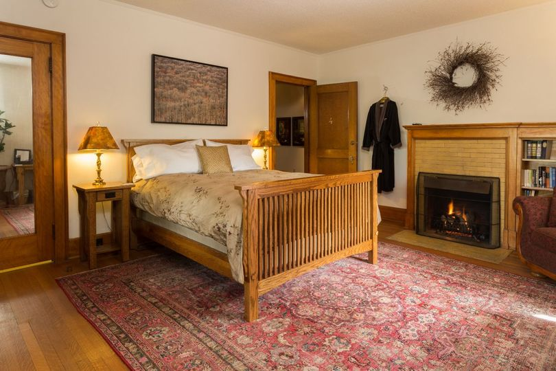 Our favorite room because of the fireplace, original leaded glass windows and soaking tub
