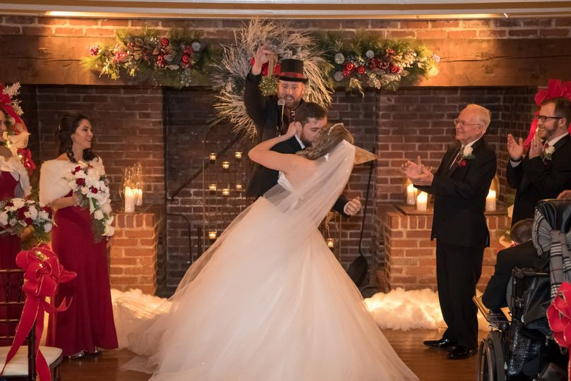 Groom dipping the bride