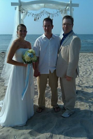 Couple with the wedding officiant