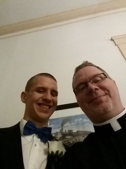 Groom with the officiant