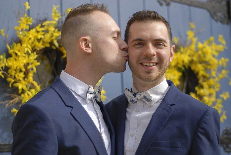 Groom kissing a groom