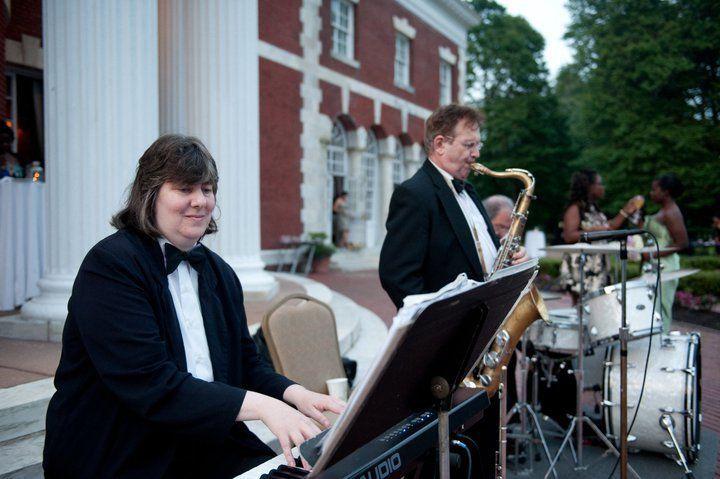 Piano, saxophone and drum trio
