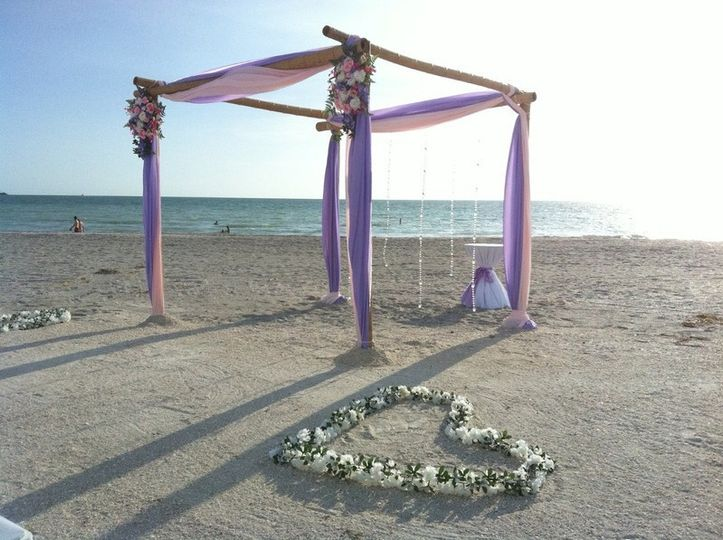 Purple wedding arbor and floral heart
