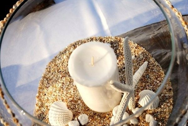 Candle centerpiece with starfish and shells