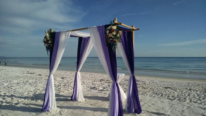 Violet and white wedding arbor