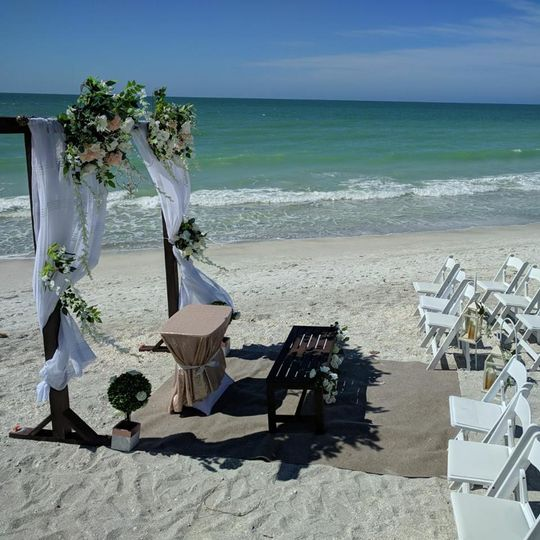 Beach Side ceremony and floral pergola