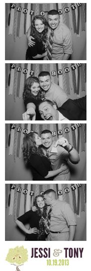 wedding photo booth with streamer backdrop