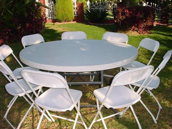 """White Folding Chairs and 60"""" Round Table"""