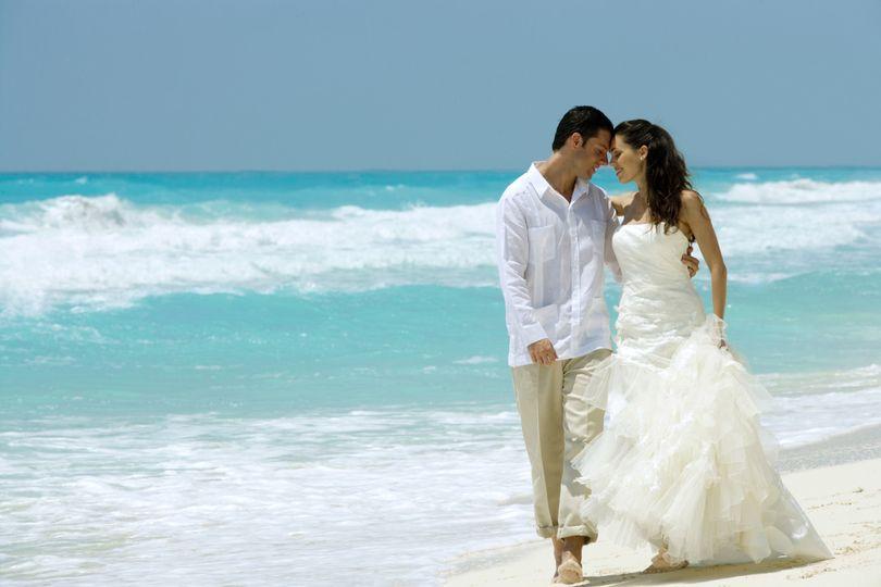 Newlyweds along the shore