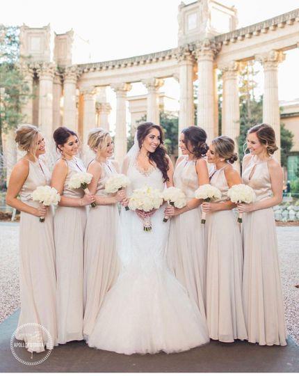 A beaming bridal party