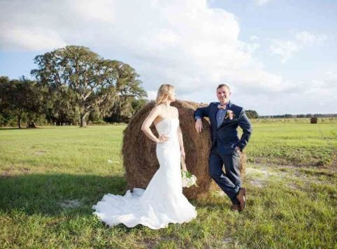 Newlyweds by the hay roll