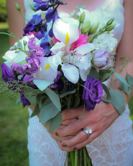 The bouquet with purple and white flowers