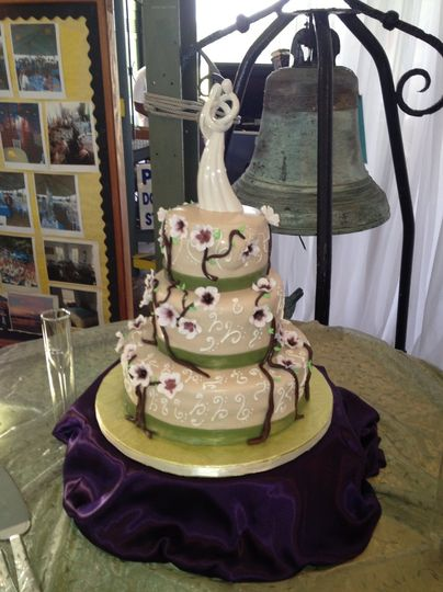 Wedding cake with green ribbons and flowers