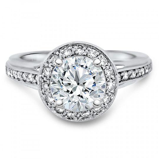 Halo engagement ring with bezel edge.
