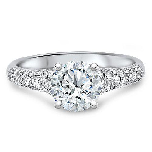 Tapered pavé diamond engagement ring.