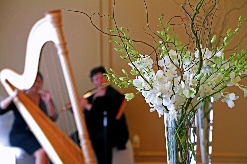 Simple sprays of white dendrobium orchids are perfect for an elegant centerpiece or ceremony...