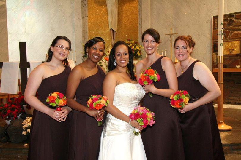 Bright gerberas and roses make these black dresses pop!