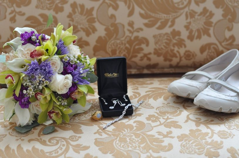 An early fall wedding bouquet shocases white, lavender and popular lime green.