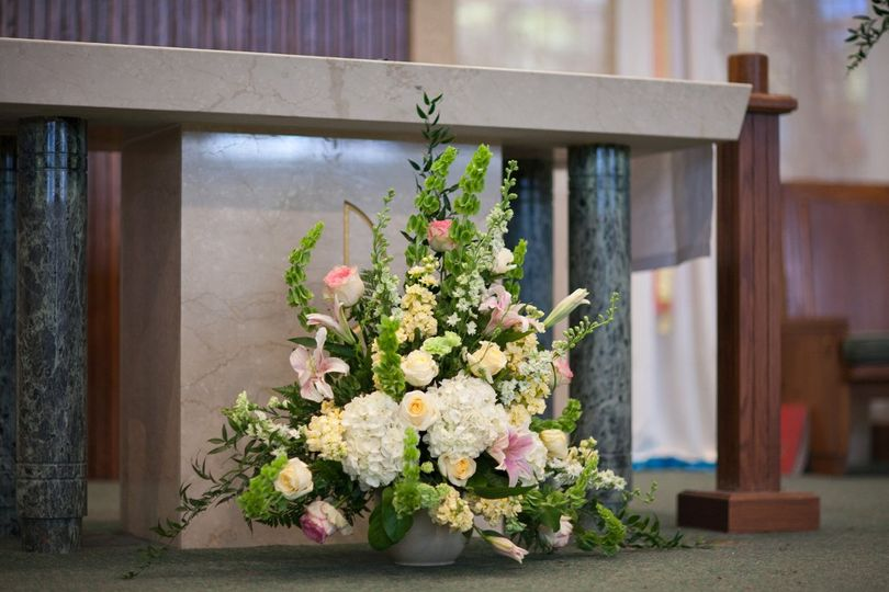 Altar arrangement of Bells of Ireland, stock and hydrangea