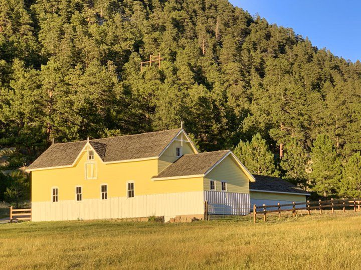 Yellow barn from meadow