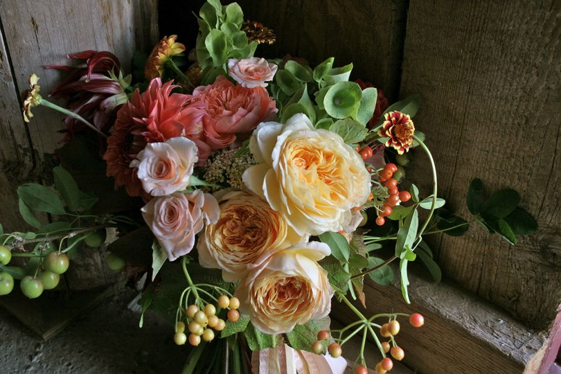 Perfect for an elegant barn wedding.  A bridal bouquet overflowing with English Garden Roses and...