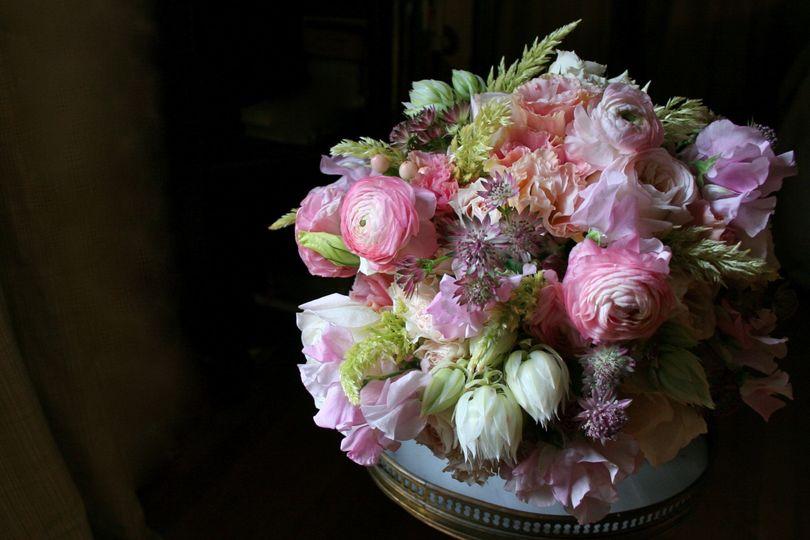 An abundant bridal bouquet by White Magnolia Designs.
