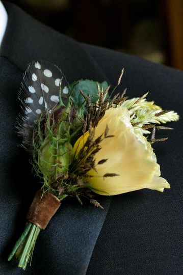 A Boutonniere for the groom full of texture with a classic masculine look by White Magnolia Designs.