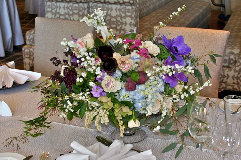 A wedding at the Four Seasons with centerpieces wild and luxurious by White Magnolia Designs.