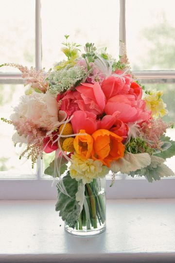 Coral Charm Peonies, poppies, astilbe and much more make up this gorgeous bouquet by White Magnolia...
