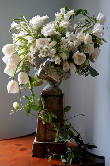 White Perfection in an old urn.  Free flowing and full of sophistication by White Magnolia Designs.