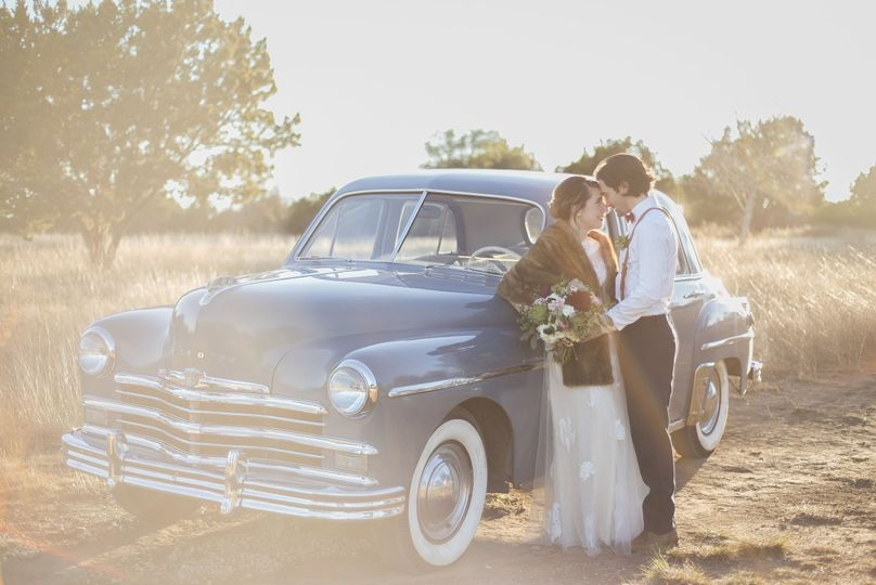 Couple photo by the vintage car