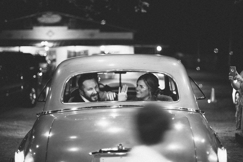 Couple inside the wedding car