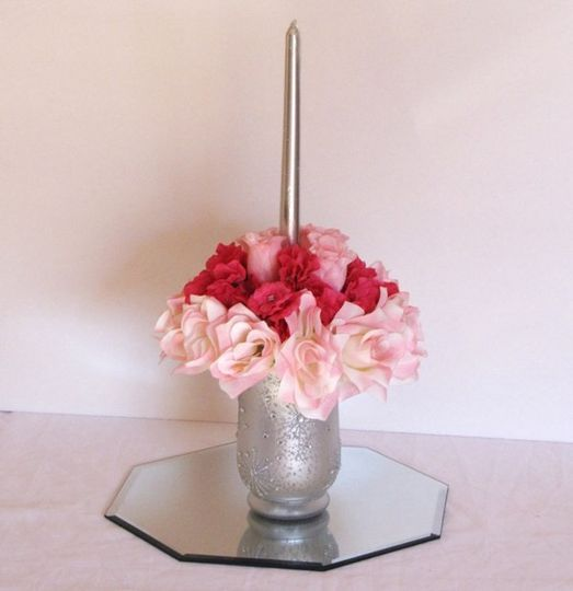 """This is an 8"""" wide wedding centerpiece using pink and ivory open roses and soft wrinkle pink..."""