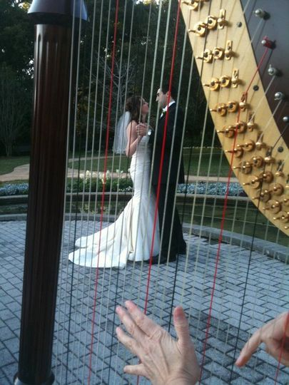 Bride & groom dancing to harp music