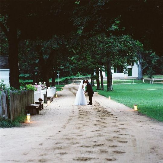 Candlelit pathways light the way for a romantic stroll.