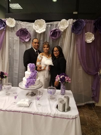 By the wedding cake