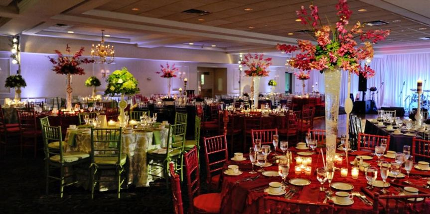 The Fairway Ballroom Decorated for a Wedding Reception with Up-Lighting.
