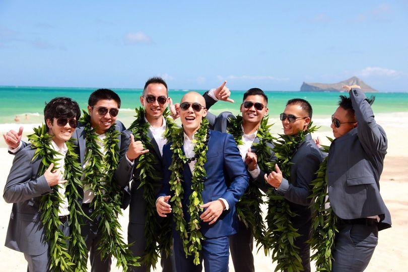 Groomsmen bonding by the ocean