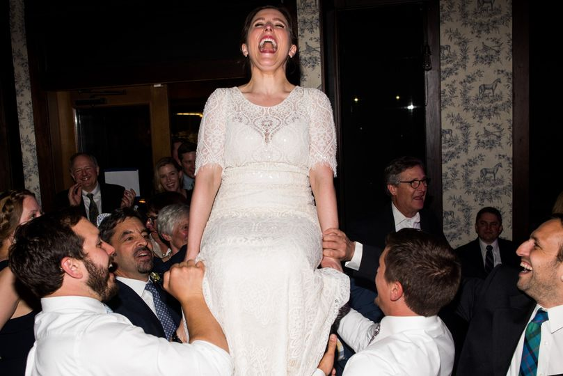 Bride carried on chair