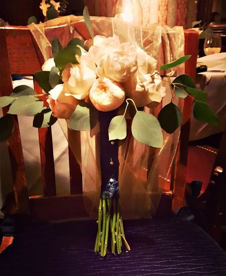Bride's bouquet, delicious garden roses make the most lovely accent to the bride's ensemble.