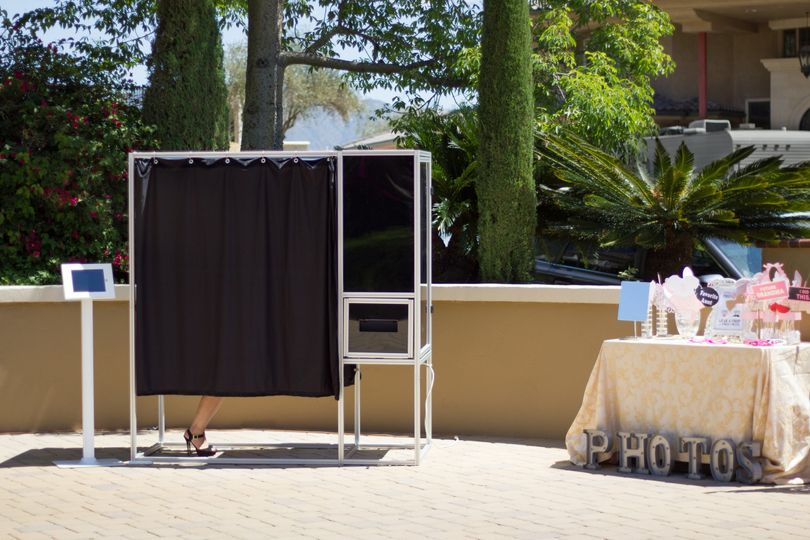 Enclosed photo booth with media kiosk