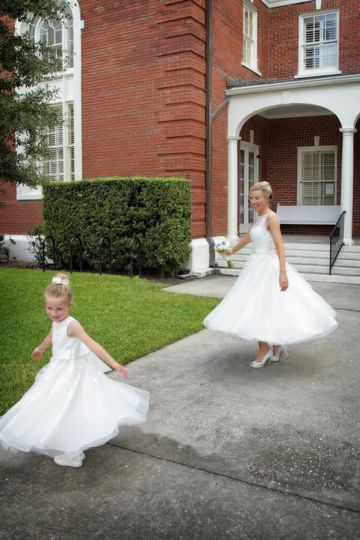 Bride and flower girl twirl